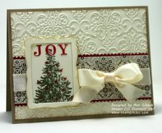 Joy Tree: Stamp Sets: Christmas Lodge, Joyous Celebrations; Inks: Cherry Cobbler, Always Artichoke, Crumb Cake, Illuminate; Designer Series Paper: Candlelight Christmas; Very Vanilla, Crumb Cake, Cherry Cobbler; Tools: Big Shot, Lacy Brocade Textured Impressions Embossing Folder, Designer Frames Textured Impressions Embossing Folder, Finishing Touches Edgelits, Brayer; Glitz and Glam: Basic Pearls, Very Vanilla Stin Ribbon (retired); Other: Red and Brown Permanent Marker (to color pearls)