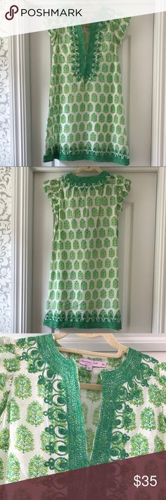 Calypso beautiful green print cotton dress/coverup Christiane Celle Calypso cotton dress/coverup. White background with green and yellow print. Green and gold embroidery around neckline, down the front and along the bottom hem. Beautiful print and color. Very good condition. Looks great as a cover up or just as a dress on a hot day with flip flops. Calypso St. Barth Swim Coverups