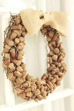 How to Make a Nut Wreath. Greet your guests with a gorgeous nut wreath. This tutorial guides you whether you choose mixed nuts or acorns. #wreaths #DIY