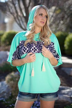 Savannah Hooded Pullover- Mint. This top is so comfy you will want to wear it every day. Lightweight and eye-catching! Great aztec color-block detailing, hood, and tassel ties.