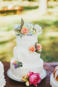 Bright florals liven up this understated white cake | Photo by Katelyn Shanice