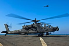 ARABIAN GULF (Dec. 31, 2014) – An Army Apache helicopter attached to 4th Battalion 501st Aviation Regiment rests on the flight deck of the dock landing ship USS Comstock (LSD 45).