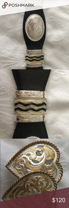 Tony Lama western belt. Womens (38) Beautiful Tony Lama western belt. Leather and silver with horse tail tie off's on each side of the conchas. Size 38 adjustable per hole. Beautiful buckle comes with it. Buckles alone cost me $90 each. Tony Lama Accessories Belts