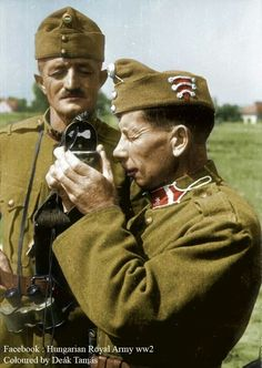 A soldier of the Hungarian Army.  I think its a camera he is holding up.  I hope so otherwise he dosent belong here.
