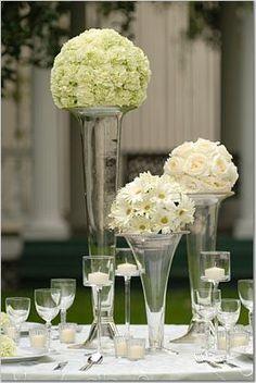Pomanders on vases for wedding centerpiece