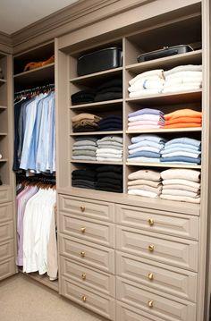 Custom closet. I like the non white shelving and simple/classic hardware selection.