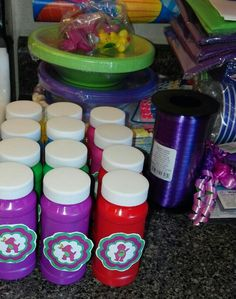 Barney Bubble Favors I bought 3pk bubbles at dollar tree. Printed out free barney printable circles I found on here.I printed in a small size,cut,and taped on bottles.