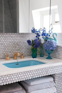 """Sneak Peek: A Colorful English Home. """"The moment I stumbled across this sink, taps and marble stand on Salvo's website, I knew I had to have it! We had many discussions regarding the best tiles to accompany the sink but we got there in the end. The marble tiles are called blanco hexagon tiles and sourced from Walls and Floors. They were installed using Bal grout in Smoke."""" #sneakpeek"""