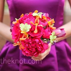 The fuchsia bridesmaid bouquets were made up of tulips, peonies, roses and orchids for a textured look