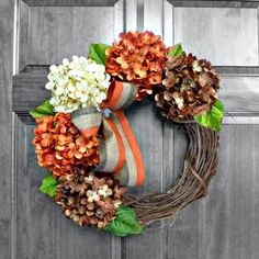 Burnt orange, chocolate and cream hydrangeas surround this grapevine wreath adorned with a burlap or fall inspired bow! So festive for the season!  *****Complimentary Upgrade: UV Resistant Coating***** This clear coating protects against any premature fading from the sun and increases the longevity of your handmade wreath.  This wreath comes WITH or WITHOUT a Monogram! To see more fall hydrangea colors and this wreath with a MONOGRAM, please visit fall collection here…