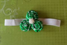 St. Patrick's Day. 3 green & white rosettes with pearl button.