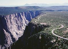 Bike South Rim Road overlooking Black Canyon of the Gunnison National Park.