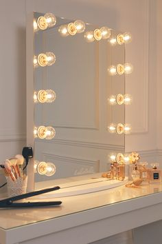 vanity mirror with a pure white finish, framed with 12 clear golf size light bulbs