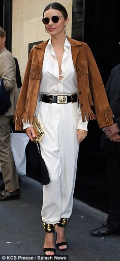 Miranda Kerr stepped out sported a sleek white jumpsuit and fringed suede jacket in Paris http://dailym.ai/1tc81xd
