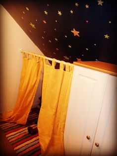 I made a little fort inside my son's closet to give the feeling of a tent...I then painted the ceiling in his closet a midnight blue and he helped me place stars all over the ceiling so he can feel like he is camping out under the stars in his fort....:)