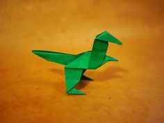 How to make an Easy Origami Dinosaur Instructions on how to make an easy origami dinosaur tutorial Music: Dinosaur Origami, Kids Origami, Origami Paper Art, Origami Ball, Origami Dragon, Fabric Origami, Origami Fish, Origami Heart, Origami Folding