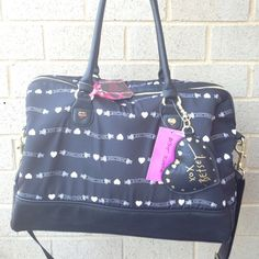 "Betsey johnson weekender bag Beautiful black & white Betsey Johson weekender bag . Bag height 13"" width is 17"" , depth is 8"" strap drop is 10 "" and long shoulder strap is 24"" . Betsey johnson logo ,  hearts & roses all over . Betsey Johnson Bags Travel Bags"