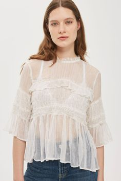 Like something out of a fairy tale, our sheer top combines glistening metallic stripes and layers of frills. Featuring a traditional smocked waist and sleeves, it boasts frilly trims to the neck, chest and cuffs, and is finished with a keyhole opening on the back. Work a weekend look by pairing with denim and trainers.