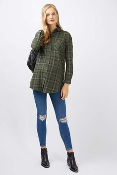 Opt for comfort balanced with style in this cool casual check shirt for Topshop Maternity. In a long line and loose fit, this shirt also comes with a button down placket and structured collar.