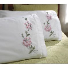 BUCILLA-Stamped Cross Stitch Pillowcase Kit includes: two standard size polyester/cotton pillow cases printed in ink that fades with washing, and easy instructi