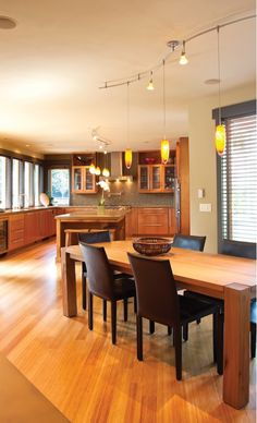 Gorgeous open custom kitchen that blends perfectly into an inviting dining room