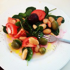 Here's an elegant salad of baby spinach, beets, tomatoes, olives, and butter beans. All that was needed to top it off was a simple drizzle of olive oil and balsamic vinegar!  Source: Instagram userjessicagauci11