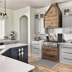 white and wood kitchen design, exactly what I want-whiter cabinets tho, and then bam! A wood accent!