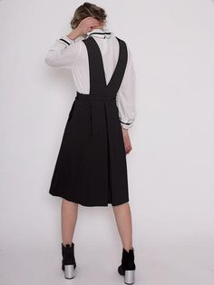 Mei Black Pinafore Dress with Deep V Neck and Pleated Skirt