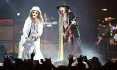 Steven Tyler, left, and Joe Perry of Aerosmith wield scarves, and the power of rock 'n' roll, during their Dec. 3, 2012, performance at Staples Center. (Gerry Gittelson/Special to the Daily News)