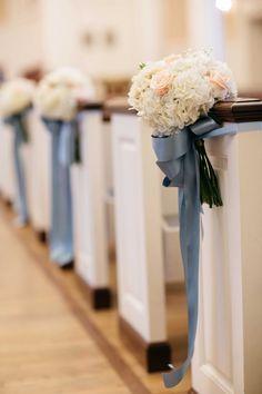 White Hydrangea & Pink Rose Pew Décor | Photography: Karlisch Studio. Read More: http://www.insideweddings.com/weddings/classic-ceremony-at-smu-chapel-ballroom-reception-in-dallas/731/