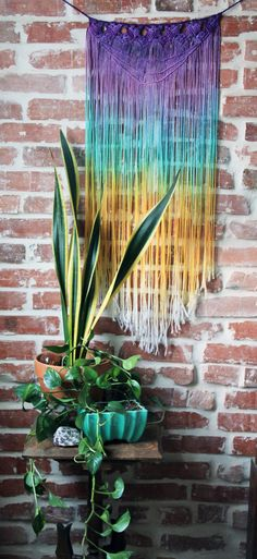 Handmade and dyed Macrame Wall, window, doorway, or anywhere Hanging.  Approx. 14wide and 40 long  Top purple, teal, golden yellow, white