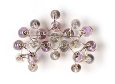 Daniel Kruger. Brooch: Untitled, 2008. Amethyst, gold, silver. Back view.  . Photo by Udo w. Beier..