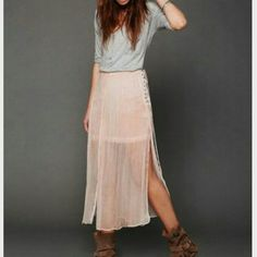 """Free People OLDIE BUT GOODIE sheer maxi skirt Sheer maxi skirt with gorgeous corset-style ties at right side of waist. Tall slits all around skirt in front and back, diving bottom portion into four pieces. Has a short skirt lining underneath made from the same material. Bottom hem of lining is raw edge.   *100% Viscose  *Machine Wash Cold  *Import   Measurements for Size Medium:  Waist (all around): 34""""  Length: 34 1/2""""  Color: Pale pink Size 12 (fits like a medium)  BRAND NEW WITHOUT TAGS…"""