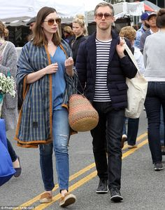 Love is in the air: The 33-year-old donned skinny jeans with a blouse and an oversized wra...
