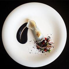 """Insalata di riso"". . Squid stuffed black rice saladgarlic cream with ink. . #kresios by tadashi_takayama"