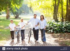 happy-indian-family-of-four-walking-outdoors-in-the-park-E6KHFM.jpg (1300×956)