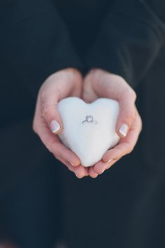 Agnes holding engagement ring in the heart shaped snow ball at saw mill stockton nj for their engagement session with ny nj wedding photogra...