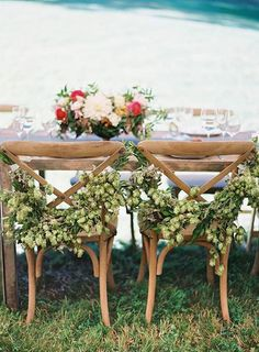 Lush garlands of hops are such a pretty way to adorn your reception chairs | Brides.com