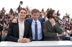 """(L-R)  Co-director Ben Safdie, actor Robert Pattinson and writer, co-director Joshua Safdie attend the """"Good Time"""" photocall during the 70th annual Cannes Film Festival at Palais des Festivals on May 25, 2017 in Cannes, France. - """"Good Time"""" Photocall - The 70th Annual Cannes Film Festival"""