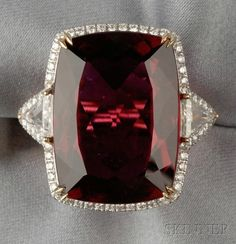 18kt Gold and Rubellite Ring, set with a fancy-cut rubellite measuring approx. 23.00 x 16.90 x 8.70 mm, flanked by triangular-cut diamonds, framed by full-cut diamond melee, approx. total diamond wt. 1.70 cts.