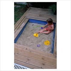 Sandpit sunken into wooden deck