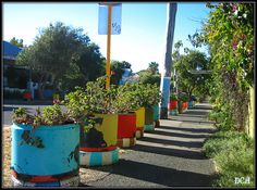 colorful recycled tires as street planters