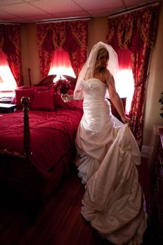 Bride finishes getting ready in a red room