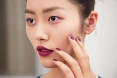 Anthony Vaccarello garnet lips and nails  | allure.com