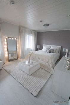 All white #bedroomdecor. Love the fur rug! || Aff