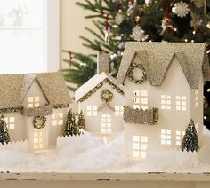 Love the white village houses. Martha Stewart has the tutorial on making these in her book.