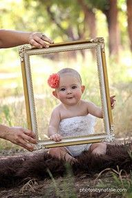 hold a frame in front of your baby. cute.