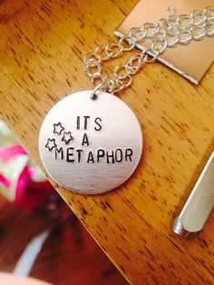 The Fault in Our Stars.  It's a metaphor by LaurensTrinketry, $15.00