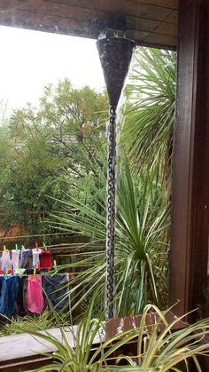Nothing sounds better or looks more mesmerising than a Japanese rain chain.  #japanesegardendesign  #home  #architecturedesign  #plumbing  #midcenturymodern #rain #melbourne