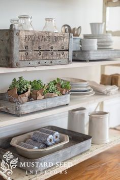 Living Room decor - rustic farmhouse style. Shelf styling with rustic crates, earthenware in soft cream and grey color palette.